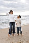 African-American mother and son at beach