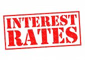 stock photo of payday  - INTEREST RATES red Rubber Stamp over a white background - JPG