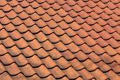 image of red roof tile  - Red roof tile pattern over blue sky  - JPG
