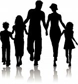 pic of silhouette  - Silhouette of a family of five out walking - JPG