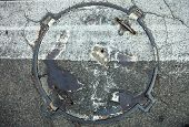 image of manhole  - Manhole with metal cover in asphalt with white zebra crossing marking line on it - JPG