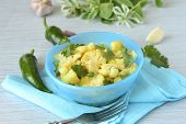 foto of cilantro  - Roasted cauliflower with cilantro in a blue bowl - JPG