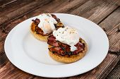 foto of benediction  - Benedict eggs with crispy bacon and hollandaise sauce on toasted Maffin on clean plate - JPG