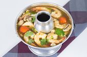 foto of cilantro  - Spicy and sour Shrimp Tom yum the most famous thai sour soup with mushrooms and spiced lemongrass kaffir lime leaf and cilantro - JPG