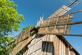image of wind wheel  - Old Wooden Wind Mill Wheel Close Up - JPG