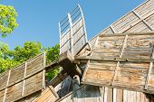stock photo of wind wheel  - Old Wooden Wind Mill Wheel Close Up - JPG