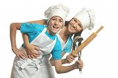 pic of ladle  - Female chef with assistant holding battledore and soup ladle  - JPG