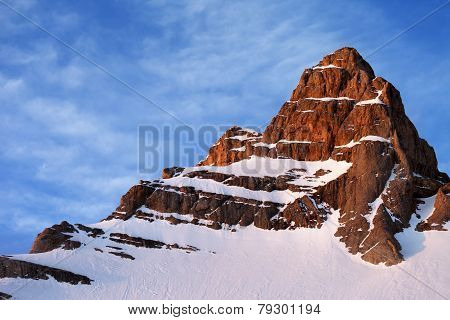 Snowy Sunlight Rocks At Sunrise