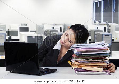 Female Employee Sleeps In Office