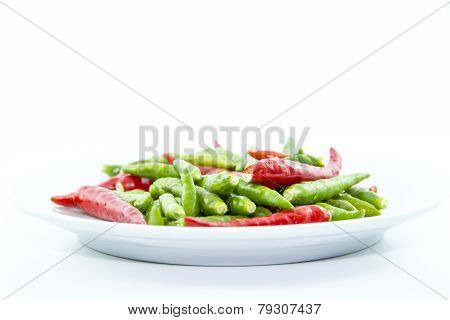 Red And Green Cayenne Peppers On White Plate