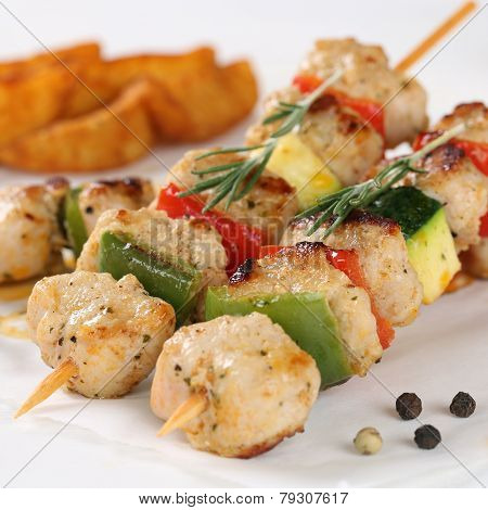 Grilled Meat Skewers With Potato Wedges