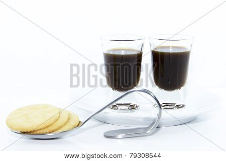 Espresso Shots On White Plate With Cracker