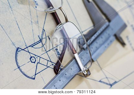 Engineering Blueprint With Glasses And Gauge