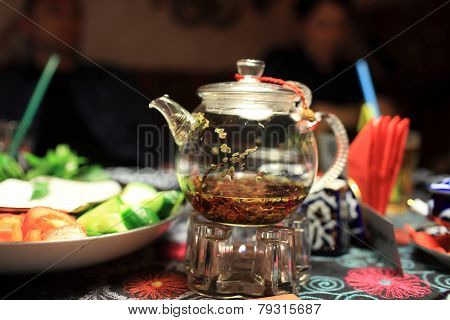 The Glass Teapot On A Table
