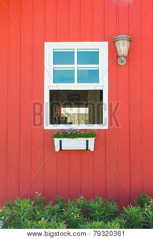 Red front door of an upscale home/Vertical shot of a red front door on a home with a mail slot, plan