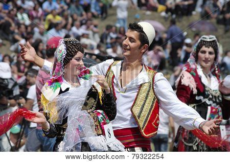 LEPUSHE, ALBANIA - AUGUST 11: a young couple in albanian costume performs a courtship dance. The beautiful girl is the winner of