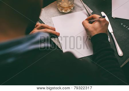 Man Writing Contract On Table