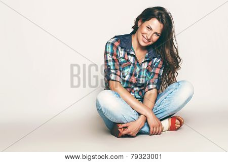 Happy Sitting Woman In Check Shirt