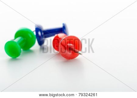 Push-pins close-up isolated on white