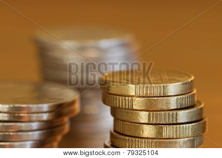 Close-up Of Pile Of Coins, Golden Background