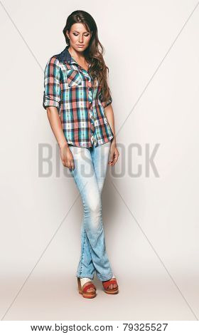 Tall Woman In Check Shirt And Blue Jeans