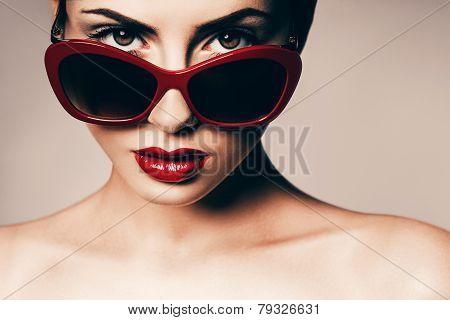 Attractive Woman In Red Sunglasses