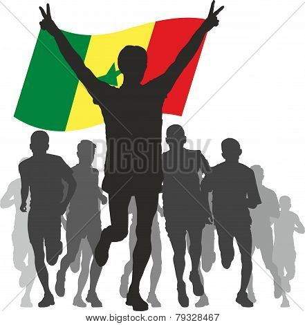 Winner with the Senegal flag at the finish