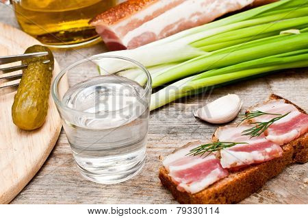 Glass Of Vodka, Onions And Bacon Sandwich
