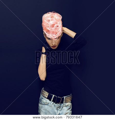 Blond Model On Black Background . Stylish Haircut. Punk Style