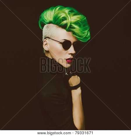 Lady With Fashionable Haircut Colored Hair On A Black Background Punk Style