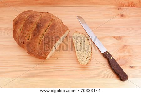 Bread Knife With A Freshly Baked Loaf