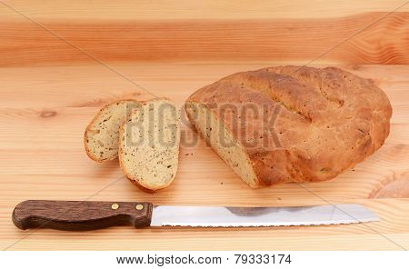 Bread Knife With Slices Of Bread Cut From A Loaf