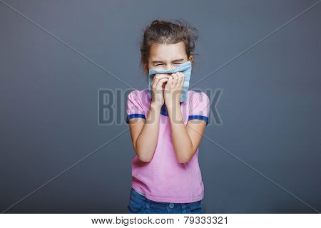 girl with a runny nose pressed handkerchief to her