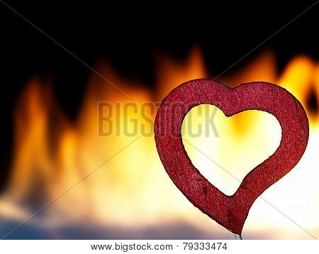 Flaming Heart On A Black Background.