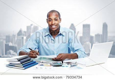 African-American Businessman over business office background