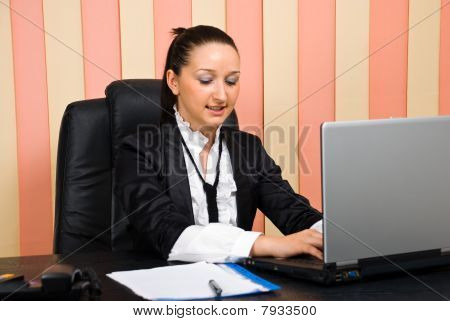 Young Business Woman Typing Laptop