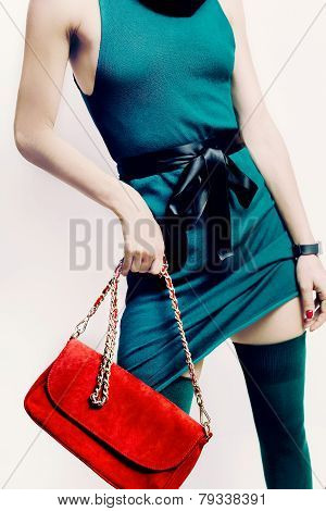 Sexy Model In A Green Dress And Stockings With Red Clutch
