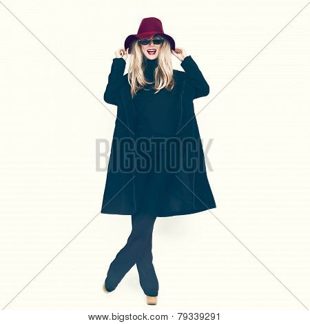 Happy Glamorous Lady In A Black Coat And Hat.