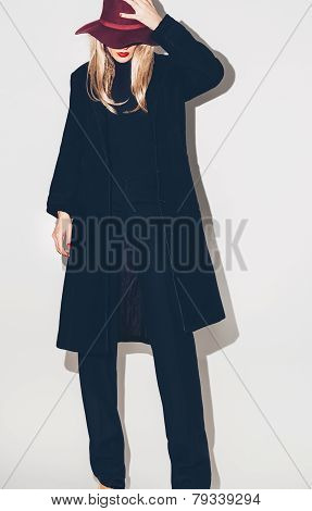 Fashion Glamorous Blonde Model In A Black Coat And Hat. Fall Winter Trends
