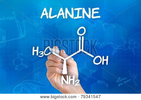 Hand with pen drawing the chemical formula of alanine