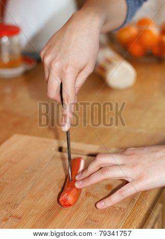 Food Preparation - Cutting A Sausage
