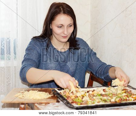 Brunette Girl Preparing A Pizza