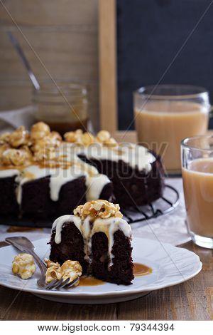 Chocolate cake with cream glaze and caramel