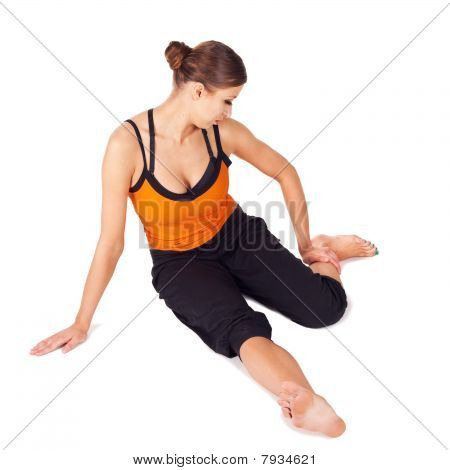 Fit Woman Practicing Yoga Asana