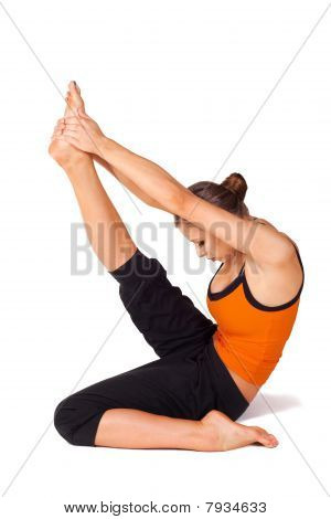 Woman Practicing Yoga Heron Pose