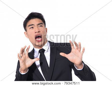Portrait of young businessman scared and afraid of something