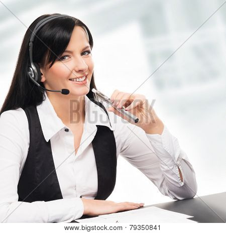 Young and attractive business woman with an electronic cigarette working in office isolated on white