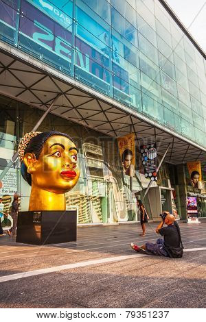 BANGKOK, THAILAND - NOVEMBER 25, 2009: Photographer take picture of sculpture Indian woman's head, dedicated to the 80th Birthday of His Majesty King Bhumibol Adulyadej India-Thai chamber of commerce