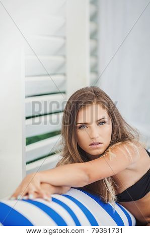 Beautiful woman on the balcony of the hotel.