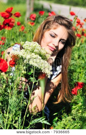 Girl With Bunch  Of Wild Flowers